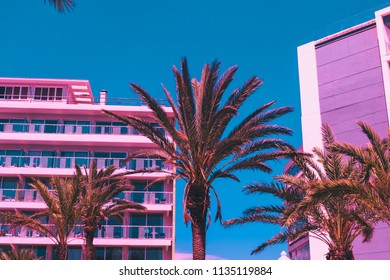 palm trees and parts of hotels in pink with turquoise sky. minimal and surreal. summer vacation. urban style