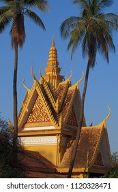 Palm trees surround the roof of a building at the Royal Palace in Phnom Penh, Cambodia