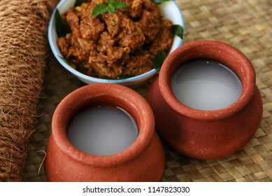 Palm Wine or Coconut Toddy popular Drink in Kerala India. It is a alcohol produced from coco tree and very commonly used in Tuvalu. Good combination with spicy hot fish or meat curry