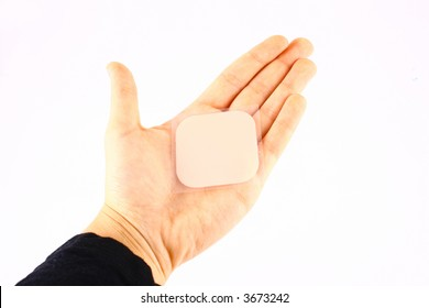 Palm of woman holds contraceptive adhesive tape