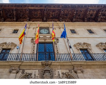 PALMA DE MAJORCA, SPAIN - 05/23/2018:  Flags outside the Town Hall at Placa de Cort in the Old Town