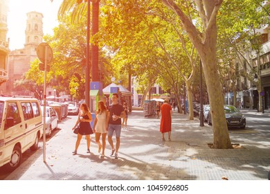PALMA DE MAJORCA, SPAIN - AUGUST 26, 2017: Three young people walk in the center of Palma in Mallorca in Spain on a summer day.