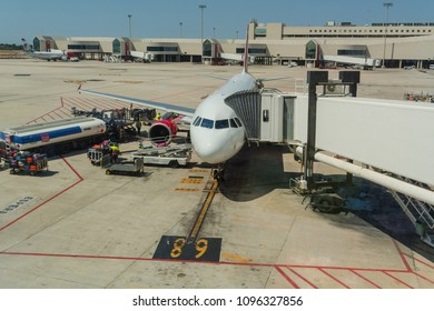 PALMA DE MALLORCA, BALEARIAN, SPAIN - JUNE 06, 2016: Airport of Mallorca, airplane in departure area during loading and refueling ready for departure.