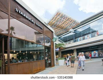 PALMA DE MALLORCA, BALEARIC ISLANDS, SPAIN - SEPTEMBER 29, 2016: Starbucks with shoppers in FAN Shopping Centre on a sunny day on September 29, 2016 in Palma de Mallorca, Balearic islands, Spain.