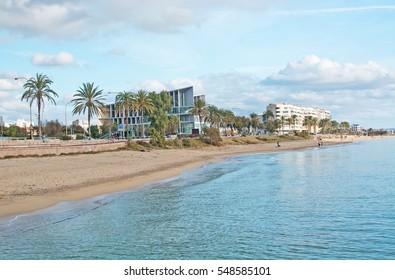 PALMA DE MALLORCA, BALEARIC ISLANDS, SPAIN - DECEMBER 1, 2016: Beach and new conference center on a sunny winter day on December 1, 2016 in Palma de Mallorca, Balearic islands, Spain.