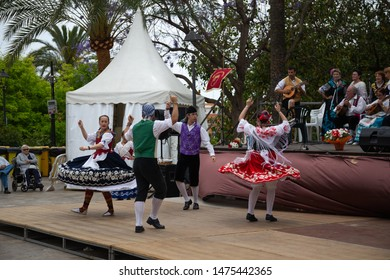 Palma de Mallorca, Spain - 09.06.19: Musicians and dancers in national costumes perform for tourists and citizens in the center of Palma de Mallorca