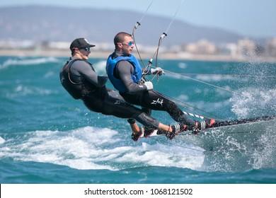 Palma de Mallorca, Spain. April 4th, 2018. 49er sailing class watercrafts compete during the Princesa Sofia international regatta in Palma bay
