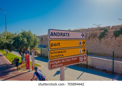 PALMA DE MALLORCA, SPAIN - AUGUST 18 2017: Informative sign with some people biking and walking around of the city of Palma de Mallorca in a beautiful blue sunny day in Palma de Mallorca, Spain
