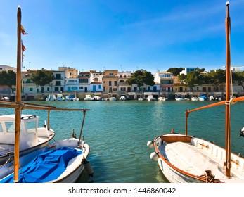 PALMA DE MALLORCA, SPAIN / Balearic - March 3, 2019: southeast COAST NEAR PORTOCOLOM. Fishing village in the mediterranean Island of Mallorca, called Portocolom with fishing houses and fishing boats.