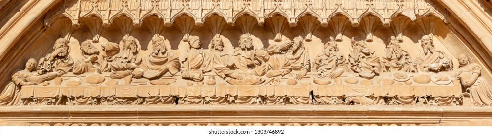 PALMA DE MALLORCA, SPAIN - JANUARY 30, 2019: The stone relief of Last Supper in the south portal of cathedral La Seu by masters Pere Morey, and Guillem Sagrera Sagrera (1389 - 1394).