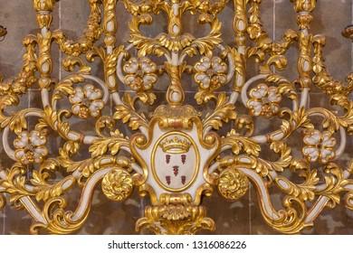 PALMA DE MALLORCA, SPAIN - JANUARY 29, 2019: The detail of baroque candlestick in the church Esglesia de la Inmaculada Concepcion.