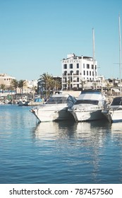PALMA DE MALLORCA, SPAIN - JANUARY 4, 2018: Portixol Hotel and marina moored boats in afternoon sunshine on January 4, 2018 in Palma de Mallorca, Spain.