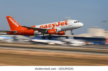Palma de Mallorca / Spain - July 28 2018: An Easyjet low fares airline Airbus A319 takeoff from palma airport, one of main destinations for British and German tourists during summer season.