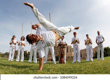 Palma de Mallorca, Spain - May 14, 2012: Capoeira dancers perform on a public park in the Spanish island of Mallorca