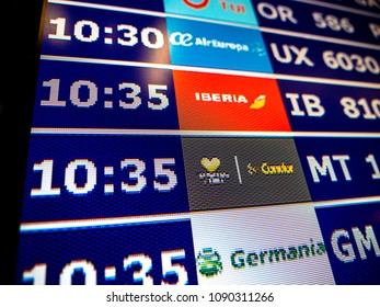 PALMA DE MALLORCA, SPAIN - MAY 11, 2018: Close-up details of a typical airport information board with mutiple airlines hours departure gates and insignia for the boarding gate Air Europa, Iberia