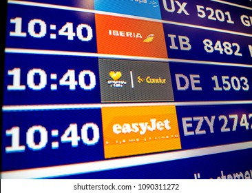 PALMA DE MALLORCA, SPAIN - MAY 11 2018: Close-up details of a typical airport information board with mutiple airlines hours departure gates and insignia for the boarding gate EasyJet Condor Iberia