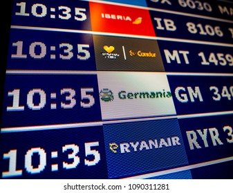 PALMA DE MALLORCA, SPAIN - MAY 11, 2018: Close-up details of a typical airport information board with mutiple airlines hours departure gates and insignia for the boarding gate Ryanair Germania Condor