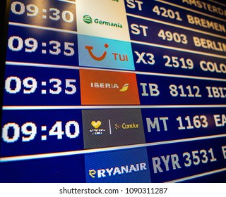 PALMA DE MALLORCA, SPAIN - MAY 11, 2018: Macro detail of display lcd screen of typical airport information board with mutiple airlines hours departure gates and insignia for the boarding gate