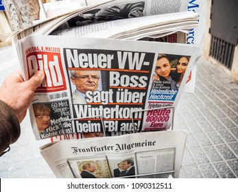 PALMA DE MALLORCA, SPAIN - MAY 8, 2018: Newspaper press kiosk stand in central Palma de Mallorca with international press featuring Bild German newspaper with Herbert Diess new Volkswagen CEO