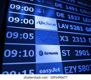 PALMA DE MALLORCA, SPAIN - MAY 8, 2018: Close-up details of a typical airport information board with mutiple airlines hours departure gates and insignia for the boarding gate AlbaStar.es - blue tone