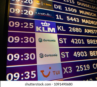 PALMA DE MALLORCA, SPAIN - MAY 8, 2018: Close-up details of a typical airport information board with mutiple airlines hours departure gates and insignia for the boarding gate KLM TUI Airlines
