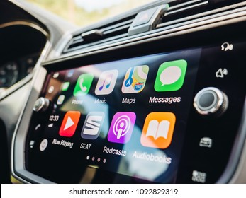 PALMA DE MALLORCA, SPAIN - MAY 10, 2018: Side view of large dashboard computer screen with apps buttons on the Apple CarPlay main screen in modern car dashboard