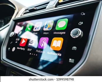 PALMA DE MALLORCA, SPAIN - MAY 10, 2018: Details of Apps and icons on the the Apple CarPlay main screen in modern car dashboard during driving