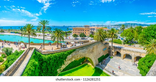 PALMA DE MALLORCA, SPAIN, MAY 18, 2017: People are strolling through Parc de la Mar at Palma de Mallorca, Spain