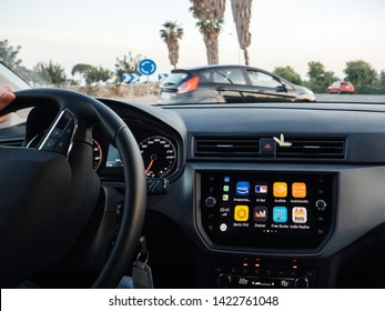 Palma de Mallorca, Spain - May 8, 2018: Digital display dashboard of modern new Seat car using Apple Car iOS with multiple applications such as Amazon music, Audible, Deezer, Maps