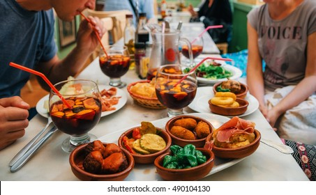 Palma de Mallorca, Spain - May 27, 2016: Tapas set and sangria in traditional spanish cafe in Mallorca, Balearic island, Spain