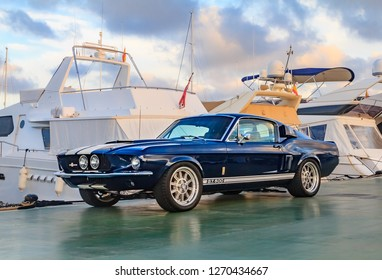 Palma de Mallorca, Spain - October 24, 2013: Classic rare American muscle car, vintage blue Ford Mustang Shelby Cobra GT-500 Fastback on a pier in Mallorca