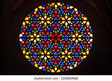 PALMA DE MALLORCA, SPAIN - SEP 30, 2018: Multi colored stained glass rose window with flower prints in Cathedral Santa Maria de Palma.
