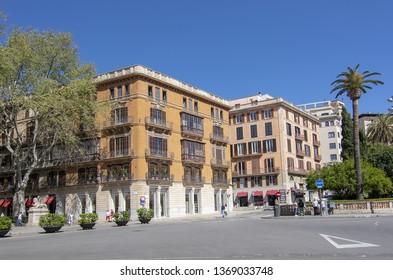 PALMA, MALLORCA, SPAIN - APRIL 9, 2019: Residential buildings on Plaza de la Reina in the city on a sunny day on April 9, 2019 in Palma, Mallorca, Spain.