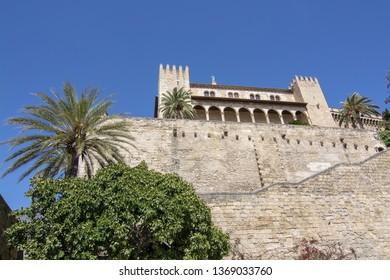 PALMA, MALLORCA, SPAIN - APRIL 9, 2019: Almudaina castle against blue sky on a sunny day on April 9, 2019 in Palma, Mallorca, Spain.