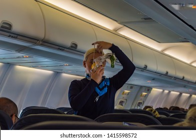 Palma - Spain 18 avril 2019: air hostess shows how to use an oxygen mask on board.