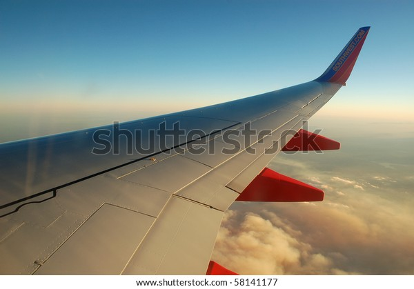PALMDALE, CA - JULY 29: A Southwest Airlines flight flies 39,000 feet above clouds of smoke from wildfires July 29, 2010 near Palmdale, CA.