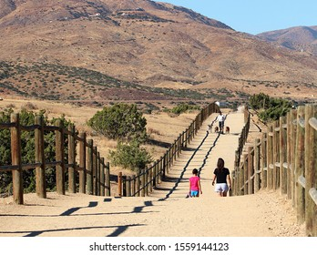 Palmdale, CA, Nov. 11, 2019: Walkers and dogs take the Barrel Springs Equestrian Trail.