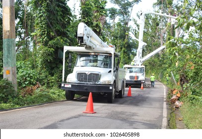 PALMER, PUERTO RICO - February 12, 2018: Utility trucks help workers restore electrical power after Hurricane Maria in February 2018 near Palmer, Puerto Rico.