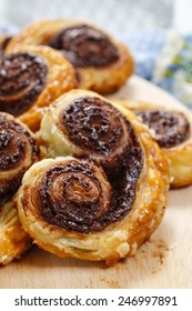 Palmier biscuits - french cookies made of puff pastry and chocolate (also called palm leaves, elephant ears, french hearts, shoe-soles or glasses)