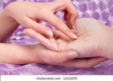Palmistry : hands reading the lines in a woman's hand