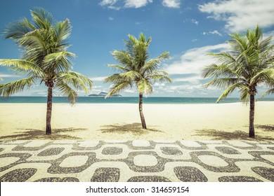 Palms with mosaic on Empty Ipanema Beach in Rio de Janeiro, Brazil