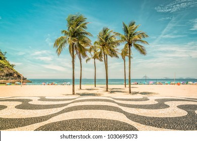 Palms on Copacabana Beach and landmark mosaic in Rio de Janeiro, Brazil