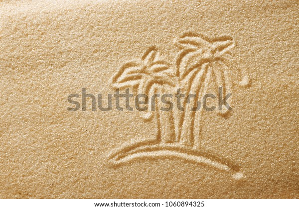 The palms are painted in the sand. Beach background. Top view. The concept of summer, summer kanikkuly, vacation, holydays.