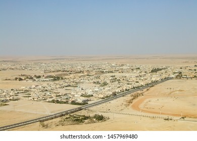 Palmyra, Homs Governorate, Syria. July 31st 2010. High viewpoint of the modern city before the war in the middle of the Syrian desert. Highway in front and vast desert landscape at the horizon.