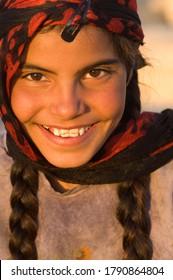 Palmyra, Syria. April 13th 2009.A pretty Syrian Bedouin girl smiling, Palmyra, Syria.