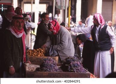 PALMYRA, SYRIA -  NOV 4, 1996 - Arab men in the market of   in Palmyra, Syria.