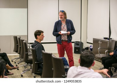 PALO ALTO, CA - DEC 3 2018: Phil Jeudy, director of Baywatch Lab moderates a discussion on the state of Crypto currencies in 2019 at a FinTech Silicon Valley event in Palo Alto.