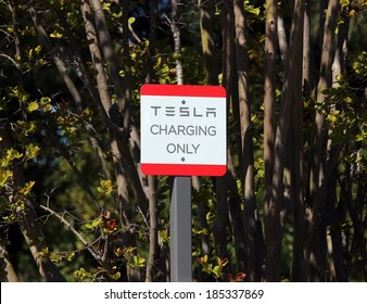 PALO ALTO, CA - MARCH 18: A charging station for Tesla brand electric cars in Palo Alto, CA on March 18, 2014. Tesla Motors is an American company that designs, manufactures and sells electric cars.
