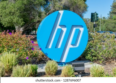 Palo Alto, CA, USA - July 03, 2018 - Blue, white round HP logo of Hewlett-Packard Company near information technology company headquarters in Silicon Valley