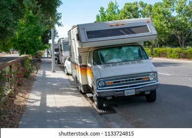 Palo Alto, California, United States - July 12, 2018: The run-down RVs and trailers parked along El Camino Real. The street has become a long-term parking destination for homeless in Palo Alto.